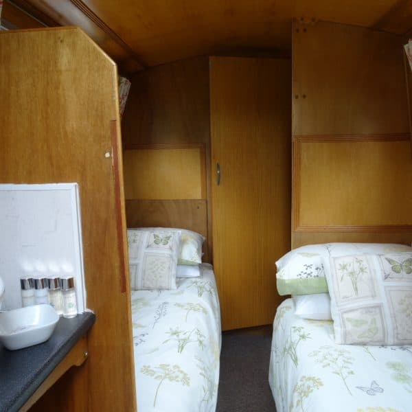 In the rear cabin there are two single beds and a wash area