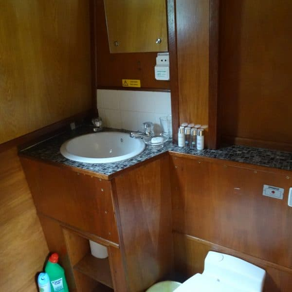 The bathroom contains a shower and electric flush toilet
