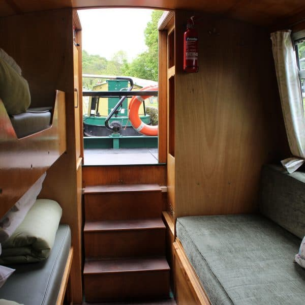 The rear cabin has the option of two singles or a large double bed aswell as the top bunk